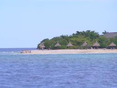 A Fiji beach with bures.
