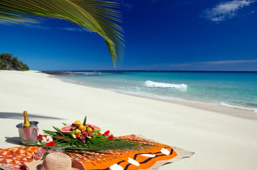 A romantic Fiji honeymoon experience. A beach picnic at Yasawa Beach & Spa, Fiji