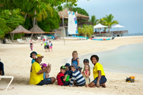 kids playing on the beach on Castaway Island, Fiji