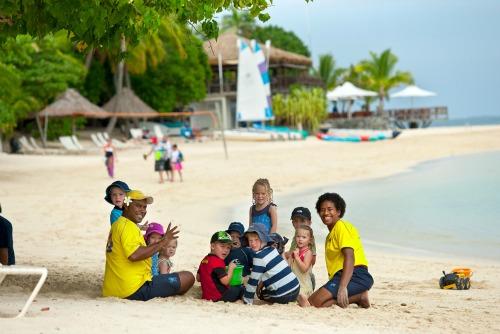 kids playing on the beach on Castaway Island, Fiji