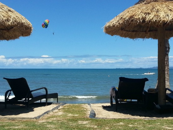 Parasailing in the distance on my Fiji vacation