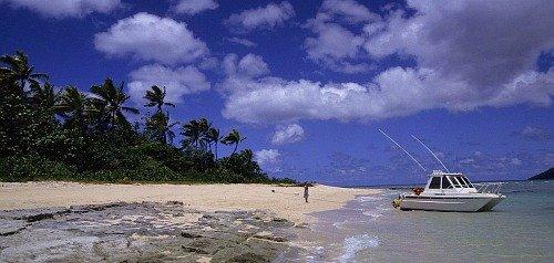 Fiji vacations - landing on a beach, Taveuni, Fij