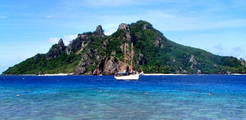 A yacht at Manu Island, on a Fiji vacation