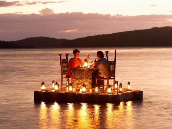 Pontoon dining for a Fiji honeymoon couple at Turtle Island Resort Fiji Islands